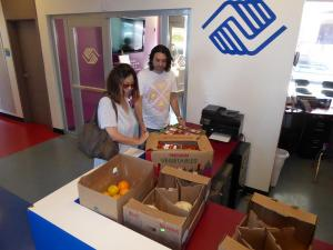 Volunteers with boxes of fruit